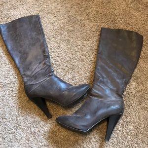 Woman's high heel brown boots